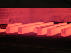 Steel blocks heated in an open-die forge in Traverse City, Michigan