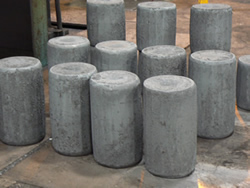 Custom steel rounds prepped for open-die forgings at Great Lakes Forge